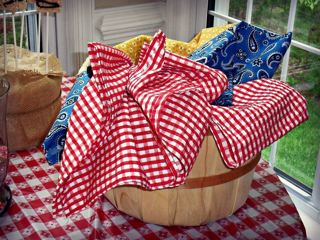 Farm Birthday Party Ideas - Bandanas as party favors stored in a basket