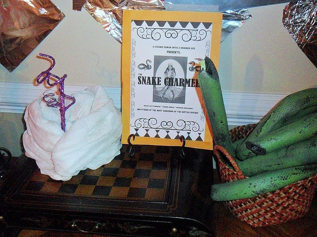 creepy carnival halloween - snake charmer