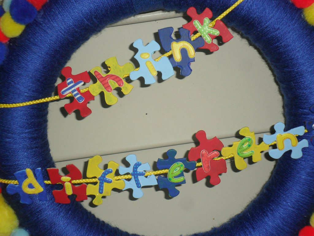 autism awareness - think different puzzle pieces