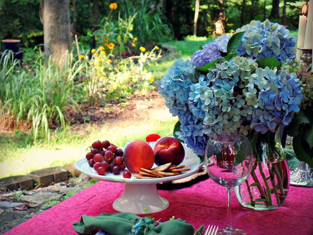 summer alfresco dining table - view of hydrangea and daylillies