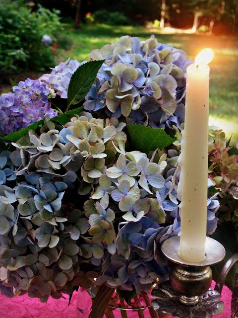 summer alfresco dining table - hydrangeas on table with candlelight