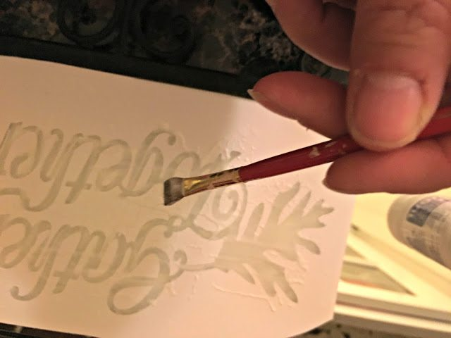Etching cream is used to etch a Thanksgiving themed mirror.