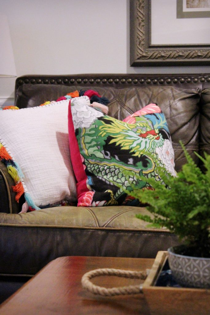 How to makeover your living room over time - throw pillows with dragon