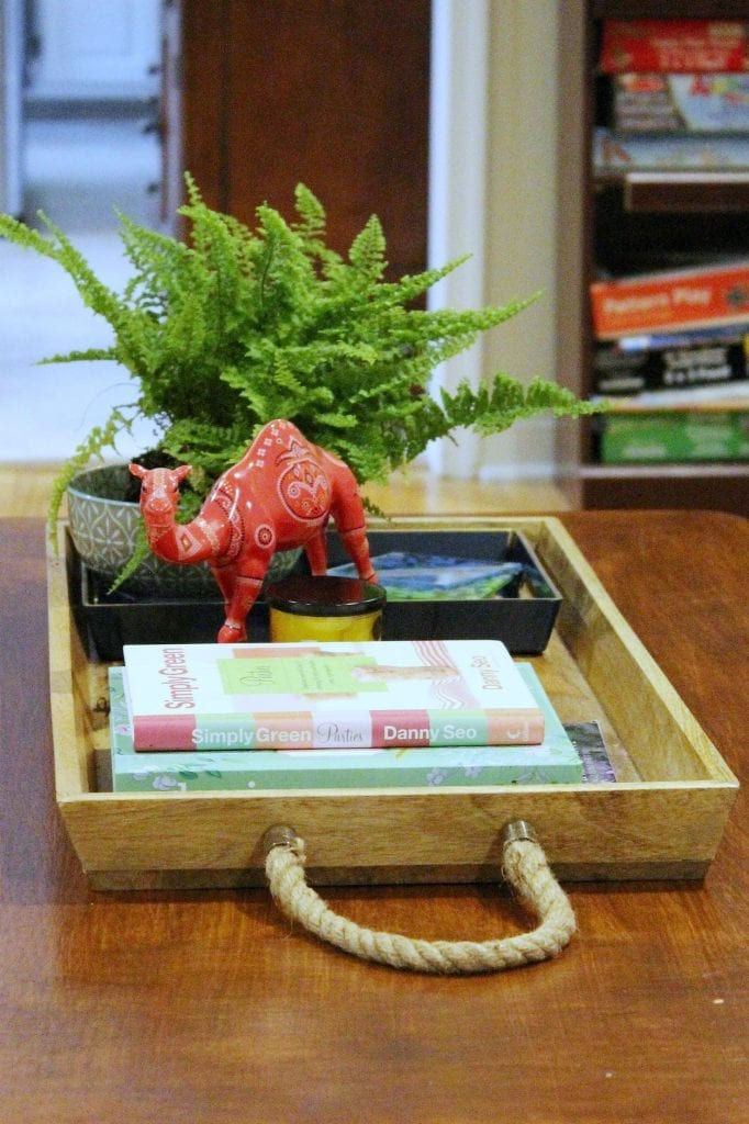 How to makeover your living room over time - tray with books and other accessories