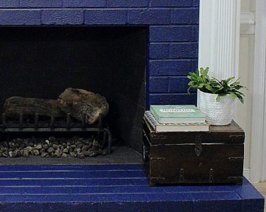 painted brick fireplace - feature