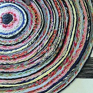 braided pom pom rug-feature